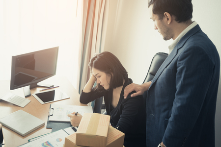 Boss is giving Consolation to a stressed office worker Stock Photo