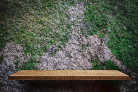 Empty wooden shelf with dirty moss cement surface