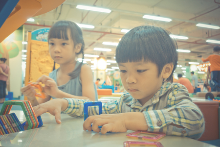 Two Asian Baby playing with Educational toy