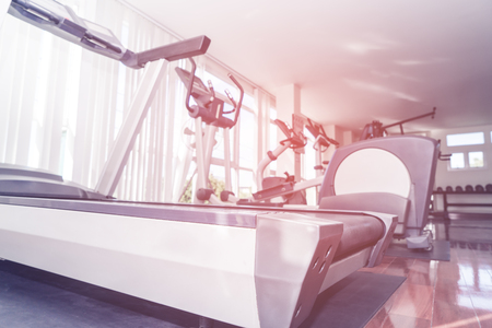 Treadmill and other fitness gym workout equipment