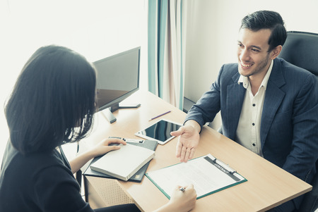 New Employee have been invited to sign work contract after successful job interview