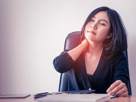 Office worker having injury on her shoulder from office health problem