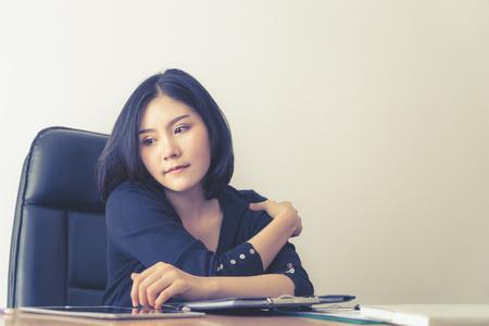 Office worker having injury on her shoulder Reklamní fotografie
