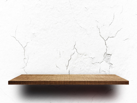 Empty wooden shelf on crack concrete wall for product display Stock fotó