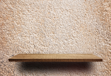 Empty display shelf on Rouch Cement stucco wall