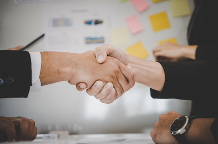 Closed up hand shaking in business meeting deal Stock Photo