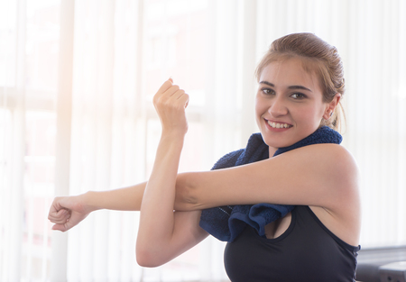 Fitness woman is stretching out her arm Banco de Imagens