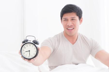 Sad Man woke up late and show alarm clock to the camera