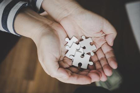 Handful of jigsaws for business options concept Standard-Bild
