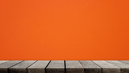 empty Wooden counter display with orange background Stock Photo