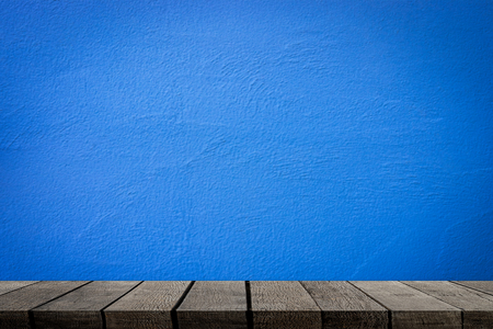 Empty wooden shelves with blue cement wall for product display Stock fotó