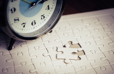 Time counting down on alarm clock to palce the last jigsaw Stok Fotoğraf