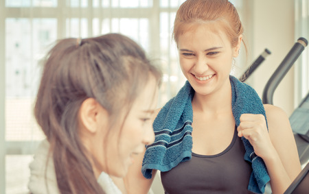 Fitness trainer is encouraging friend to train harder