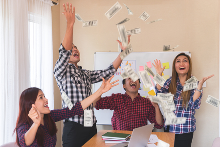 Casual Business team is throwing money for success