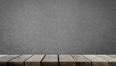 Blank wooden display shelf on gray cement wall Stock Photo