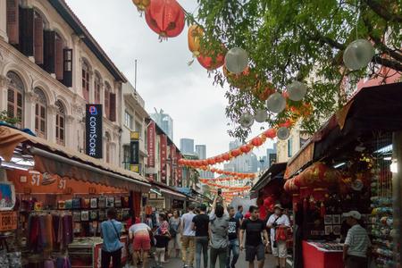 Singapore, Singapore - 1st April, 2018: People walking in China town shopping street, Singapore.