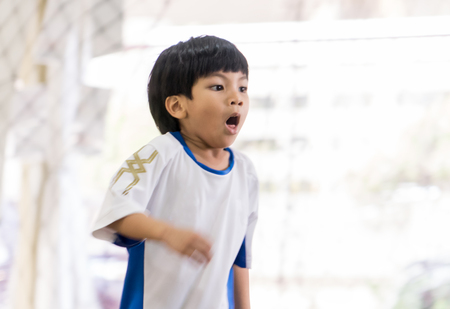 Sport boy with asthma is coughing and breathing hard Stock Photo