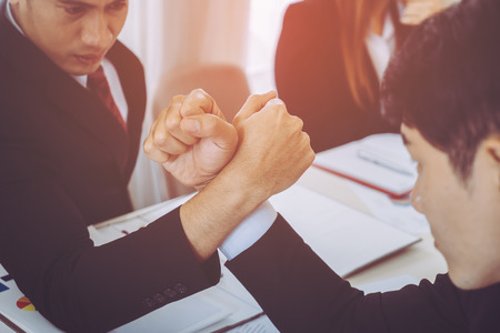 Arm wrestling in business meeting for business competitive cocnept Stock Photo