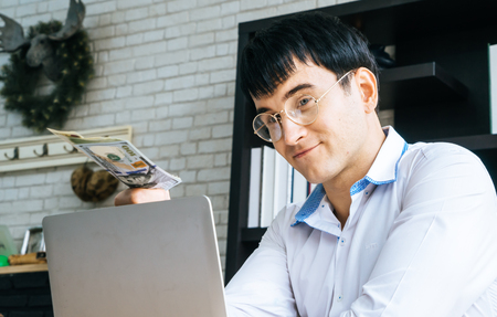 Rich Business man is offering bribery money Stock Photo