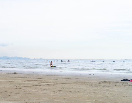 Island beach wave with people playing water sport