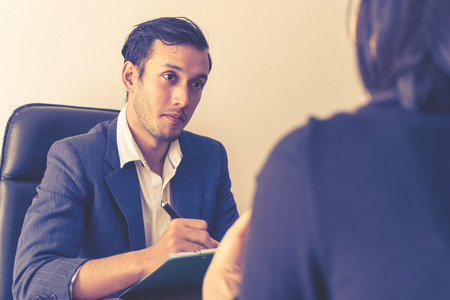 Executive is taking note in business job interview