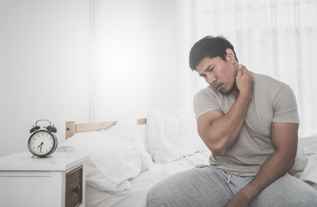 Male woke up having neck pain from sleeping