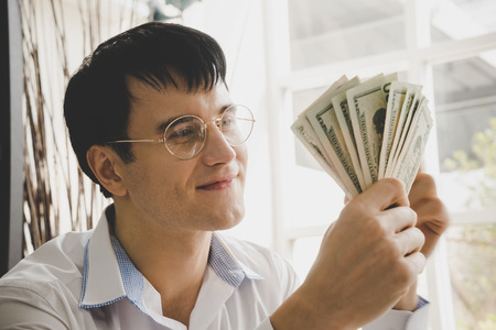Business man is counting of more money