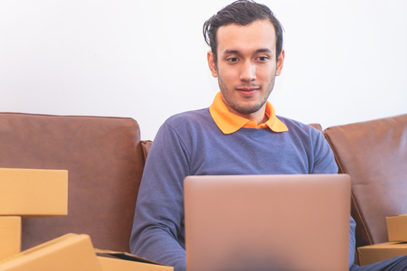 Casual Business man is working on computer on sofa