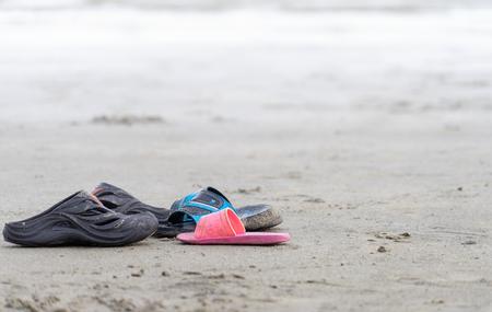 Family sandals left on the beach