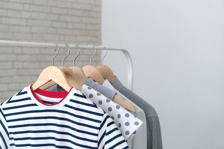 Variety of female shirt hanging in a row in a stylist room