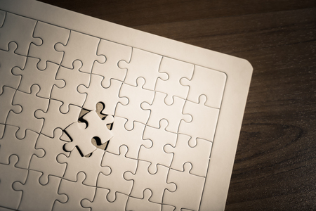 placing the last jigsaw for business solution concept Stock Photo