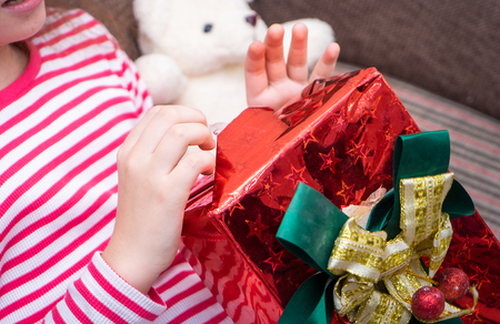 Girl in red is open Christmas surprise box present