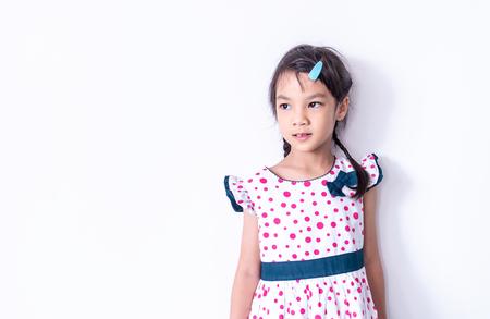 Little Asian girl portrait in sweet vintage dress Standard-Bild