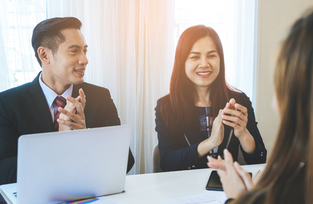 Business team is clapping applaud for successful meeting Stock Photo