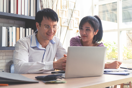 Happy Business Couple is working together at home Stock Photo