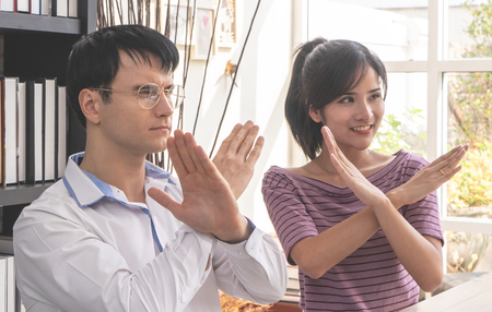 Couple business people showing no rejected gesture