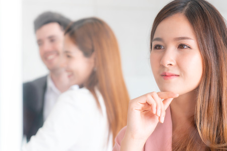 Female office worker is dreaming thinking about her marry wedding life