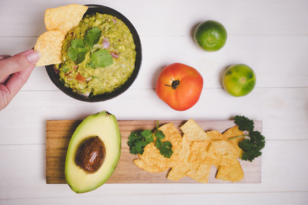 Guacamole Avocado with chips mexican food flat lay top view Stock Photo