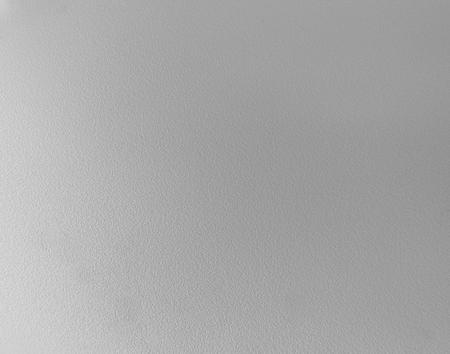 Grijze kunststof textuur leer zoals oppervlakte achtergrond Stockfoto
