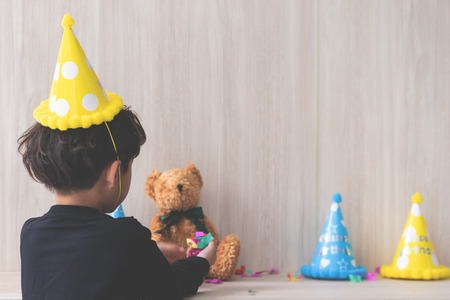 Little boy is setting up his birthday party