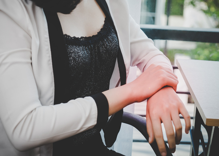 Female worker having office syndrome injury on her wrist carpal tunnel