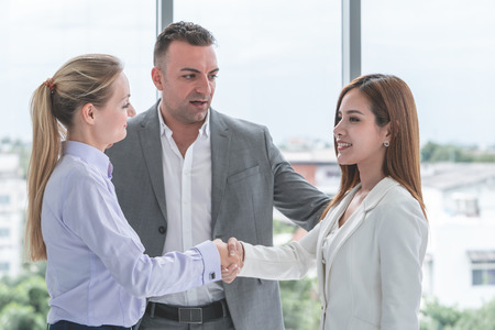 Business man is introducing partners to each other Stock Photo
