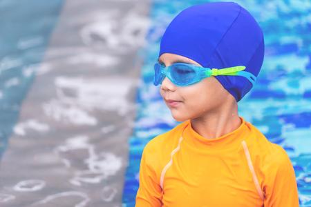 Wet suit swim Asian boy with swim glasses portrait Stock Photo