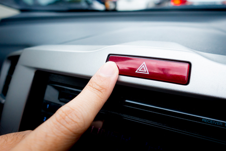 Pushing Red light hazard emergency button on a car console