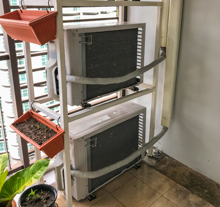 Air conditioner compressor on condominium balcony