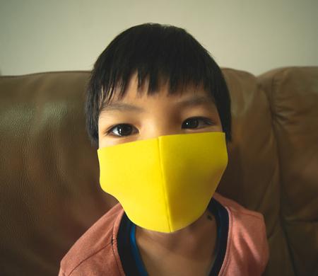 Little boy is wearing healthy mask protection from flu 免版税图像