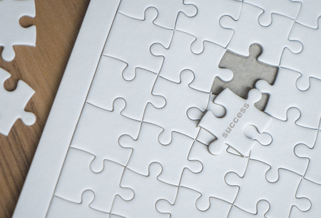 Last piece of jigsaw is almost in place for business success concept Reklamní fotografie
