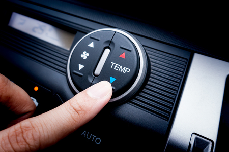 Finger pressing on Temperature switch of a Car air conditioning system Stok Fotoğraf - 108674378