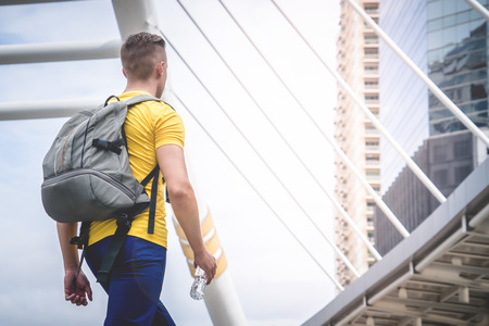 Sporty Man traveler with backpack is traveling in modern city 版權商用圖片