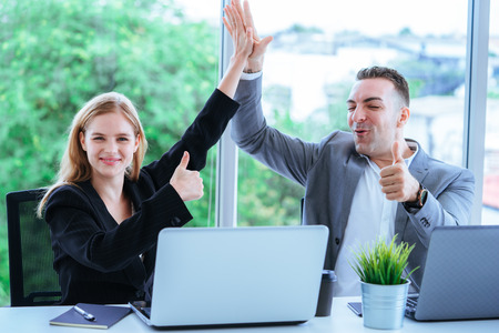 Business man and woman hand high five for team concept